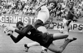 Moroccan goalkeeper Ben Kassou Allal catches the ball as he dives in front of German forward Gerhard Mnller June 1970 in Leon during the World Cup first round soccer match between Germany and Morocco.